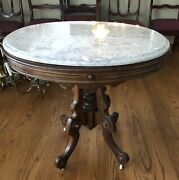 Antique Victorian Oval Ornate Walnut Pink Marble-top Parlor Table, Circa 1890