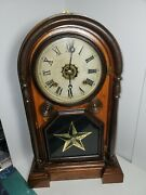 Welch Spring And Co. Clock With Rosewood Case Reverse Painting Of A Star