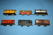 Lot Of 5 Marx Tin Litho Freight Cars And 1 Up Tender. 552 553 554 3824 59