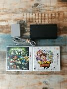 New Nintendo 3ds Super Mario Black Edition System W/charger And 2 Games