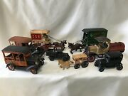 Antique Cast Iron Toys. Cars, Trucks, And Carriages. Lot Of 8