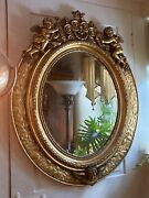 Vintage Gold Gilt Oval Mirror With Cherubs And Leaf Accents