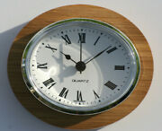 Oval Clock Suitable For Caravans Motorhomes And Boats. Roman With Silver Bezel