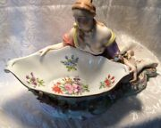 A Beautiful Meissen Painted Ceramic Figure Of Sitting Woman,arms Rest On A Bowl