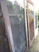 One Vintage 1950s Farmhouse Screen Storm Door W/ Metal Curlicue Weathered