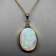 18k Gold Crystal Solid Opal And Diamond Pendant