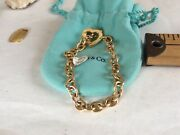 18k Signed And Dated Bracelet With An Heart And Moveable Arrow