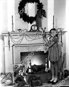 8b20-20650 Natalie Wood And Her Dog Hang The Christmas Stockings By The Fireplac