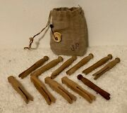 11 Antique Wood Clothespins With A Signed Brown Linen Drawstring Storage Sack