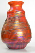 Iridescent Red Vase With Gold Pulled Feather Design. Blown Glass