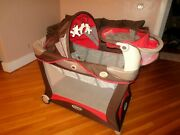 Red And Brown Deluxe Graco Playpen With Bassinet And Changing Table