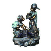 A Helping Hand Boy And Girl Fountain