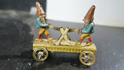 German Tin Penny Toy Gnomes Sawing Wood A Log Meier