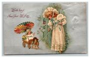 Vintage 1908 Winsch Back New Years Postcard Silver Face Baby In Wagon Cute