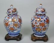 A Good Pair Of 19th Century Imari Porcelain Lidded Vases On Stands
