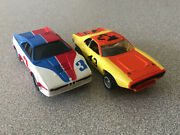 2- Aurora Afx Slot Cars 1- Bmw M-1 And 1- Plymouth Roadrunner