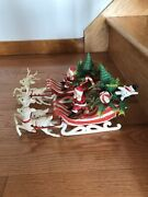 2 Vintage Plastic Santa Red And White Striped Sleigh And Reindeer Snowman Packages