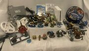 Nintendo Wii Console Lot With 2 Games, 54 Skylanders, Case, And 3 Portals