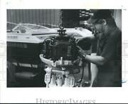 1989 Press Photo Mechanic Tends To Boat Engine Maintenance And Repair