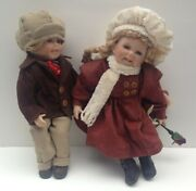 Collectible Porcelain Dolls Of A Little Boy And Little Girl