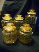Vintage Mid-century 5 Piece Amber Glass Canister Set