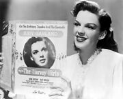 Judy Garland Holds Up Sheet Music For The Harvey Girls 8x10 Inch Photo