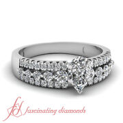 1 Carat Pear Shaped Three Row Pave White Gold Diamond Ring With Round Accents