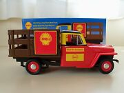 Spec Cast - Shell Oil Company Dealer 1953 Willys Jeep Stake Bed - Bank / Diecast