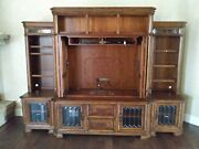Large Entertainment Center Walnut Color With Doors Shelves And Lighted.