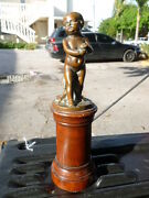 Semi Antique Bronze Statue An Angel Or Putti Mounted On Round Wooden Plinth
