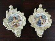 2 French Themed Clay Pottery Ornate Wall Hangings Early 1900s Women Traveling