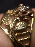 10k Gold Ring With Rose That Is Rose Gold . Has A Very Small Diamond. 1.9 Grams