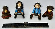 Cast Iron Amish Figures - 4 Pieces - Man, Boy And Girl On Bench