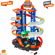 Hot Wheels City Ultimate Garage Track Set With 2 Toy Cars And Moving T-rex Dino