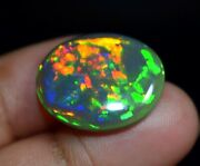 Pure Black Natural Aaa+ Quality Ethiopian Opal 12 Cts. Galaxy Fire Oval Gemstone