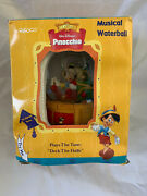 Enesco Pinocchino Christmas Musical Waterball . Plays The Tune Deck The Halls