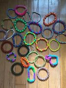 60 Bracelet Lot With Kandi, Rubber Band, Small Beaded, And Other Bracelet Items