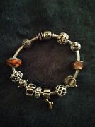Genuine Pandora Charm Bracelet With 14 Silver And 14k Gold Charms.