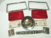 1967 Original Jeepster Commando Misc Parts Badges And Tail Light Lenses