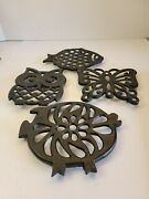 Lot Of 4 Cast Iron Trivets Marked Vg Inc.includes 1 Fish 1 Owl 1 Butterfly 1 Pig