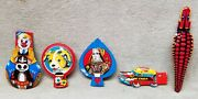 5 Vintage Tin Japanese Toy Whistles And Clickers.