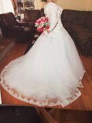 Gorgeous Long Sleeve Wedding Ball Gown With Intricate Designs And Crystals.