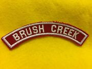 Brush Creek - Red And White Community Shoulder Strip