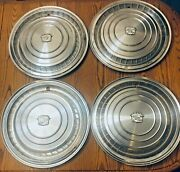 A Set Of 4 1960 Cadillac Factory Original Hubcaps.
