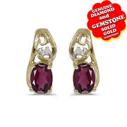 0.99 Ct Oval Cut Garnet And Natural Diamond 14k Yellow Gold Stud Earrings