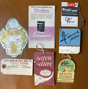 Seven Antique Advertising Tags