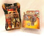 2 Lot Pirates Of The Caribbean Spinning Medallion Keychain/jack Sparrow Figure