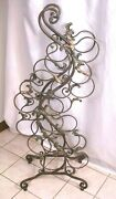 Wrought Iron Wine Rack 12 Bottle Free Standing Victorian Scroll Copper Tone Leaf