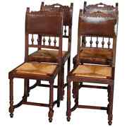 Four Antique French Renaissance Carved Walnut And Leather Dining Chairs