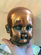 Vintage Copper + Brass Baby Doll Head Factory Mold, Shiny, Spooky